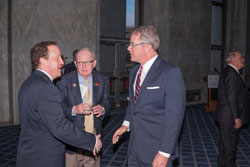 Left to right: AEVR's David Epstein greets Cong. Howard Coble (R-NC) and Kirk Bell of his staff