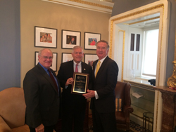 National Eye Institute (NEI) Director Paul Sieving, MD, PhD, left, joins while NAEVR President Peter McDonnell, MD (Wilmer Eye Institute/Johns Hopkins University School of Medicine), right, present a plaque to Cong. Pete Sessions (R-TX)