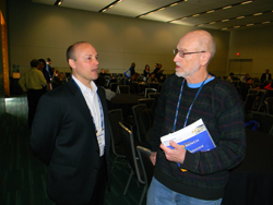 At NAEVR's session, VRP Science Officer Marc Mitchell speaks with Anton Reiner, PhD (University of Tennessee Health Science Center) who received funding from the DOD's Psychological Health-Traumatic Brain Injury Research Program in FY2015