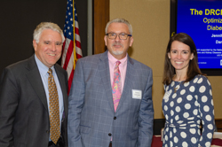 Michael Duenas, OD, left, and Alison Manson, right, of the American Optometric Association with AEVR Executive Director James Jorkasky