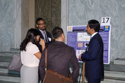 Staff from the office of House Energy and Commerce Committee Chair Fred Upton (R-MI) at the poster of Rajesh Rao, M.D. (Kellogg Eye Center/University of Michigan) detailing his work on AMD and eye cancers