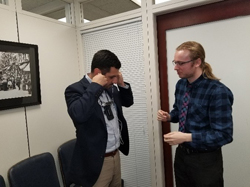 "Matthew Fuentes in the office of Senate Minority Leader Chuck Schumer (D-NY) tests a wearable ""Sensory Substitution Device"" that can convert vision into patterns of sound, enabling users to learn to see again through their remaining senses, being developed by Giles Hamilton-Fletcher, PhD (NYU Medical Center)"