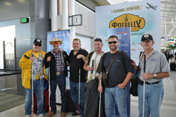 From left: BVA President Mark Cornell, recent combat-injured veterans Adam Rowland, Jason Pepper, Chris Rader and Aaron Hale, and BVA Board member Tom Zampieri, Ph.D. at Dulles Airport as they prepare to board the flight to London Heathrow