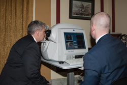 AEVR Executive Director James Jorkasky has both eyes imaged real-time by Carl Zeiss Meditec's David Speer, who also imaged staff members' eyes and explained the results