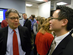 Left to right: Senator Al Franken (D-MN) speaks with Dr. Sit at a constituent breakfast held the morning of the briefing