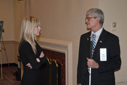 Left to right: Alicia Kerry Jones (American Optometric Association) speaks with Tom Zampieri, Ph.D. (Blinded Veterans Association)