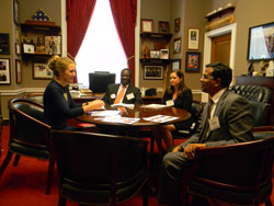"Emily Erb, office of Cong. Pete Sessions (R-TX), left, discusses with the group the Congressman's support for medical research—especially that into retinal regeneration. In 2009, Cong. Sessions was a co-sponsor with then-Cong. Tammy Baldwin (now a Wisconsin Senator) of H. Res. 366 which designated 2010-2020 as ""The Decade of Vision"""