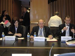 SMRB Chair Norman Augustine (center) prepares for the meeting, flanked on the right by William Roper, M.D., M.P.H. (University of North Carolina at Chapel Hill), who chairs the Substance Use, Abuse and Addiction Working Group, and on the left by Amy Patterson, M.D., NIH's Director of the Office of Science Policy, who also serves as the SMRB's Executive Secretary