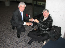 Senator Ben Nelson (D-NE) offers Dr. Kimberling a bandage to cushion a blister he developed during his busy schedule of Hill visits. Senator Nelson and Senator Susan Collins (R-ME) developed the Senate amendment to the economic stimulus bill to reduce spending and increase tax cuts which retained the $10 billion funding level for the NIH.